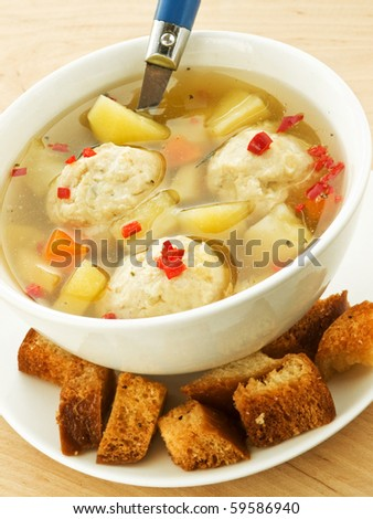Soup with chicken meatballs and croutons. Shallow dof.