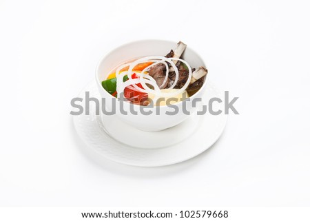 soup with meat and vegetables with white background