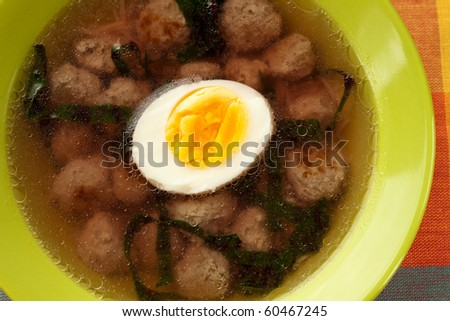 Soup with meatballs and an egg
