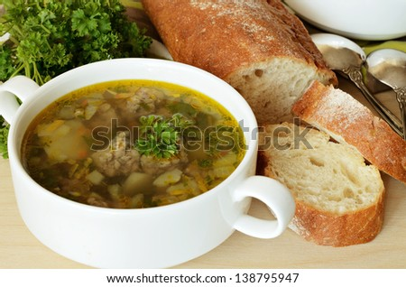 Soup with meatballs served with bread