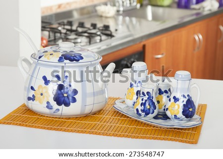 soup with milk jug salt and pepper in kitchen background in kitchen background