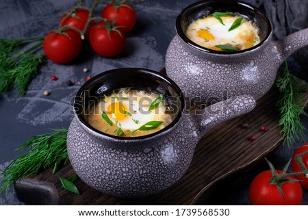 Soup with poached egg in cocotte  Stock fotó ©