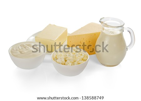 Sour cream, cottage cheese, milk, cheese and the butter, isolated on white - stock photo