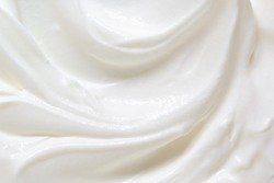 Sour cream, greek yogurt texture. White dairy product swirl closeup. Creamy healthy natural food macro photography. Top view
