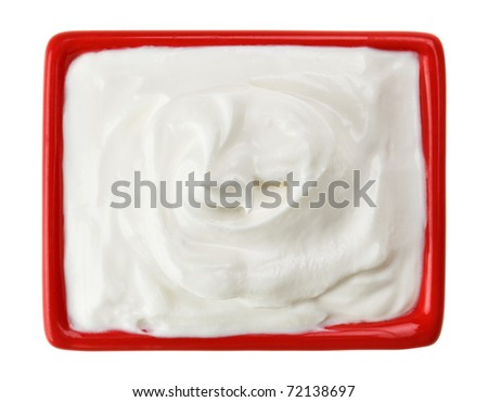 Sour cream in red small square plate, isolated on white
