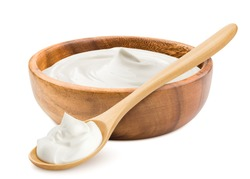 sour cream in wooden bowl and spoon, mayonnaise, yogurt, isolated on white background, clipping path, full depth of field
