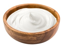 sour cream in wooden bowl, mayonnaise, yogurt, isolated on white background, clipping path, full depth of field