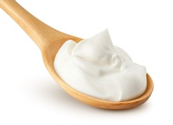 sour cream in wooden spoon, mayonnaise, yogurt, isolated on white background, clipping path, full depth of field