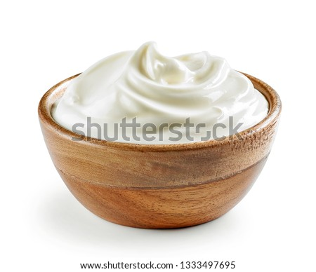 sour cream or yogurt in wooden bowl
