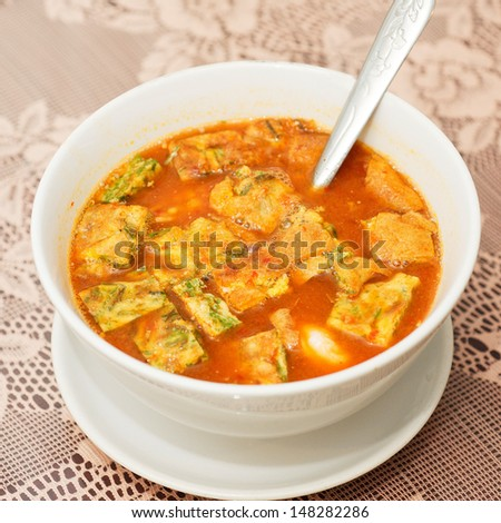 Sour soup made of tamarind paste (thai food)