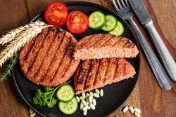 Source of fibre plant based vegan soya protein grilled burgers, meat free healthy food close up