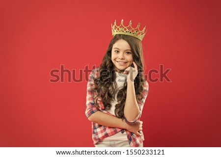 Source of pride. Proud little girl wearing crown jewel with pride on red background. Adorable small child with long curly hair feeling great pride. Pride concept.