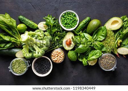 Source of protein for vegetarians. Top view healthy food clean eating: vegetable, seeds, superfood, leaf vegetable on dark background