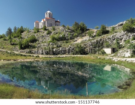 source of river Cetina with the church in village Cetina in Croatia