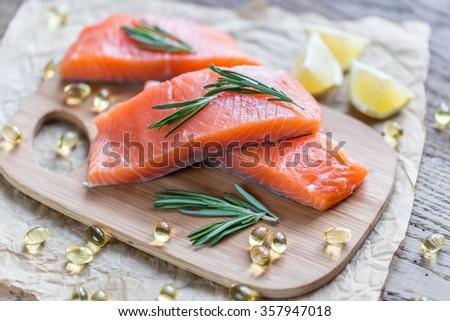 Sources of Omega-3 acid (salmon, shrimps, Omega-3 pills) #357947018