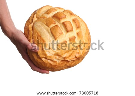 Sourdough bread loaf held by a woman's hand.