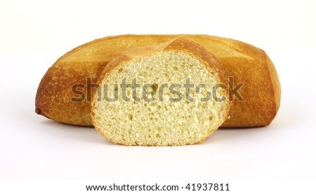 stock photo : Sourdough bread loaf with single slice in the foreground