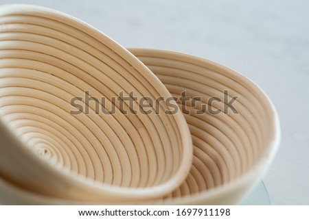 Sourdough Starter Kit with two rattan basket with green scoring lame with cover.  Photo stock ©