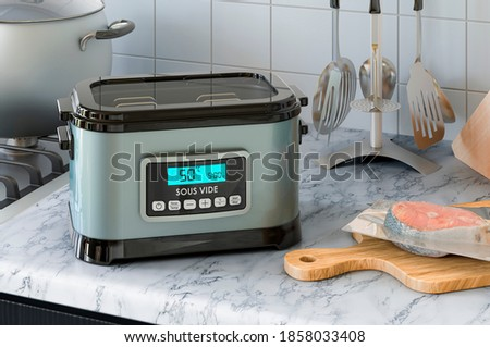 Sous vide machine on the kitchen table. 3D rendering Photo stock ©