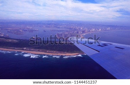 South Africa: Airshot from Durban Harbour out of a DC-10 sightseeing-flight  #1144451237