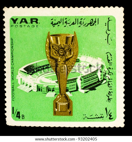 "SOUTH AFRICA - CIRCA 1974: a stamp printed in SOUTH AFRICA shows stadium shows in South Africa, first cup depicts Greek goddess Nike ""Golden Goddess"" by the Parisian jeweler Abel Lefler, circa 1974 - stock photo"