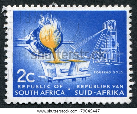 SOUTH AFRICA-CIRCA 1961: A stamp printed in the South Africa, depicts Pouring Gold, circa 1961