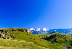 South Africa Drakensberg national park,Giants Castle,green scenic panorama,sunny blue sky,few clouds, mountains,valley creek