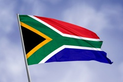 South Africa flag isolated on sky background. close up waving flag of South Africa. flag symbols of South Africa.