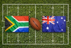 South Africa vs. Australia flags on green rugby field
