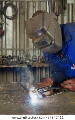 South African or American black worker welding