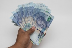 South African Rands Notes in a hand