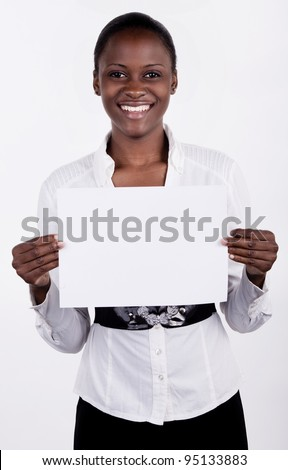 South AFrican woman holding up a blank paper for copyspace.
