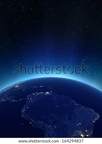 South America city lights. Elements of this image furnished by NASA