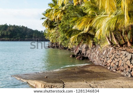 South America, French Guiana, Ile St. Joseph. Boat launch and view of Ile Royale.