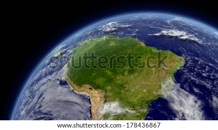 South America viewed from space with atmosphere and clouds. Elements of this image furnished by NASA.