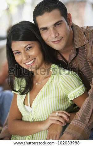 South American couple hugging - stock photo