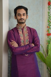 South Asian\Indian brown young man in Hindu traditional cloths posing for a photoshoot.