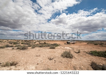 South Australia – Outback desert with 4WD track under cloudy sky as panorama - vintage