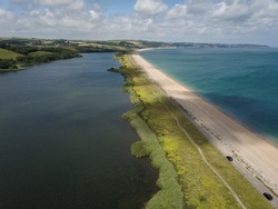 South Devon near Bigbury on Sea and Burgh Island. Drone aerial view flying high.  Blue clear water, sea, ocean on sunny day. Slapton