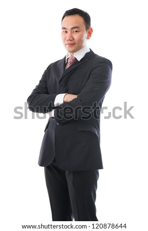 south east asian business man standing chinese ethnicity , crossed arm