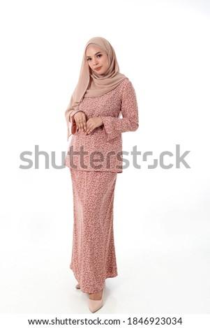 South east Asian Malay race ethnic origin woman wearing dress costume baju kurung tuding headscarf on white background Photo stock ©