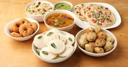 South Indian breakfast Uttapam, Idli or idly, Wada or vada, sambar, appam,  upma served with chutneys, selective focus
