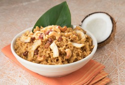 South Indian Sweet pongal made from rice, milk, jaggery and dry fruits.coconut sweet pongal