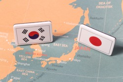 South Korea and Japan flags on map