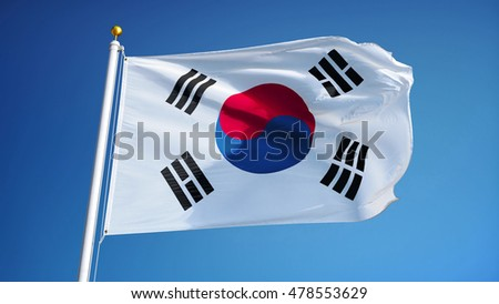 South Korea flag waving against clean blue sky, close up, isolated with clipping path mask alpha channel transparency #478553629