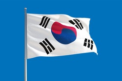 South Korea national flag waving in the wind on a deep blue sky. High quality fabric. International relations concept.