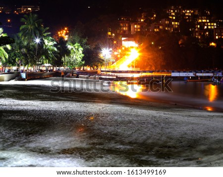 South Patong Beach at night with views of the villas on the Hill Stok fotoğraf ©