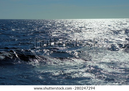 South Sea. Blue waves. The sun glitters on the waves. Philippines.