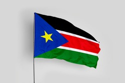South Sudan flag isolated on white background with clipping path. close up waving flag of South Sudan. flag symbols of South Sudan.
