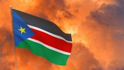 South Sudan flag on pole. Dramatic background. National flag of South Sudan